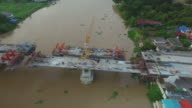 Bridge under construction in over the Chao Phraya River in Thailand video