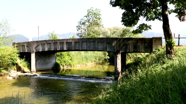 Bridge with waterfall in summer video