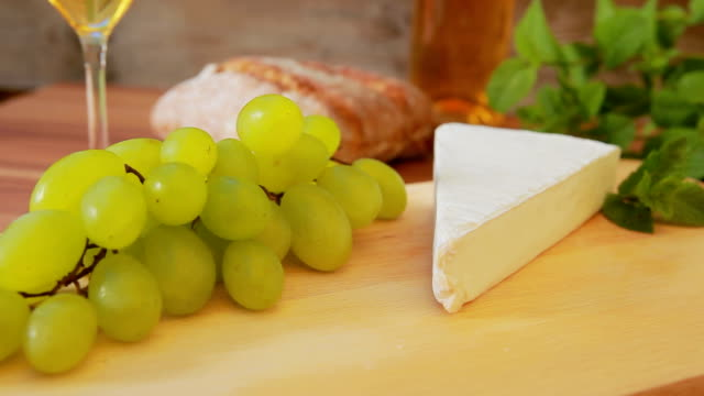 Brie cheese with white wine, grapes and bread. video