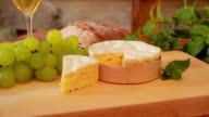brie cheese with white wine video