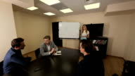 Briefing of young business team in a meeting room video