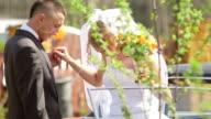 Brige and groom leaving car - Stock Footage video