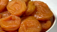 Bright Dried Apricots on a Plate video