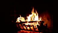 Bright flame of fire burns in an old fireplace video
