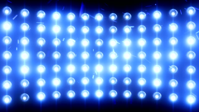Bright flood lights background with particles and glow, blue tint video