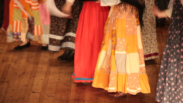 Bright fragment of Russian folk dance with colorful girls waved skirt video