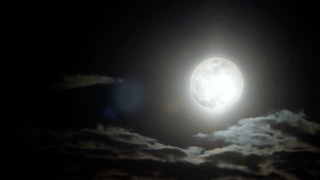 Bright moon ball under starry shade illuminates fallen asleep town protecting it video