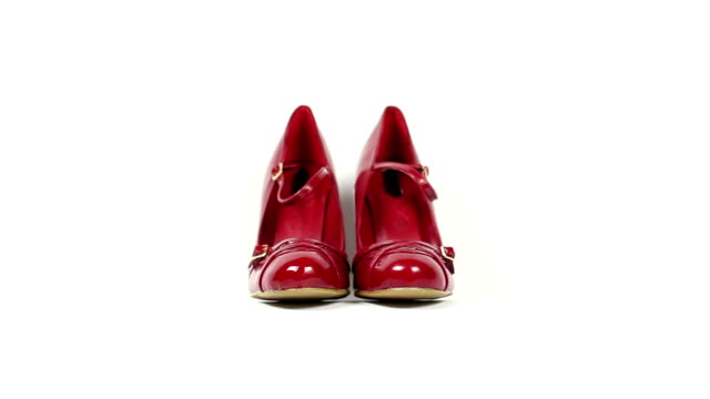 Bright red shoes coming into focus - DOLLY video
