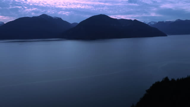 British Columbia Evening Aerial with Mountain Islands in Ocean by Silhouette Forest video