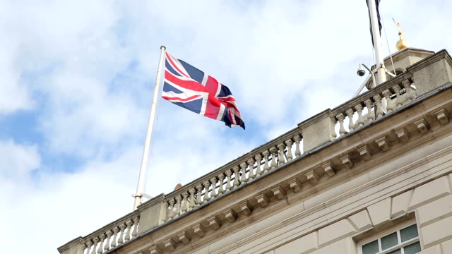 british flag on traditional building in London video