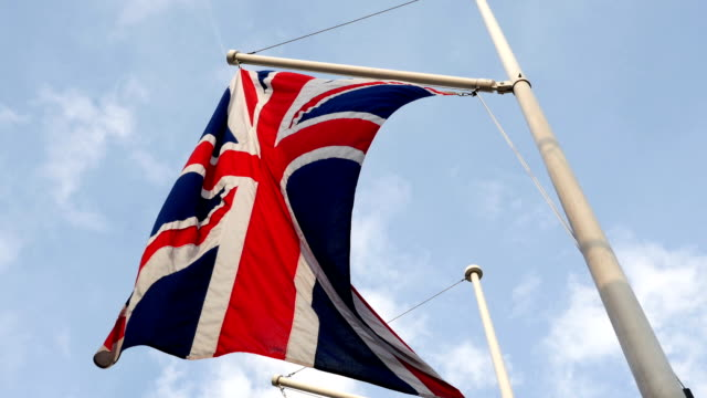 British flag waving in wind in UK, United Kingdom, national symbol video