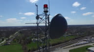 Broadcast Microwave Dish and Tower Beacon aerial view video