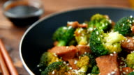 Broccoli and beef cooked on olive oil video