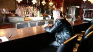 HD: Broken Man at Bar as Barman Packs Stools video