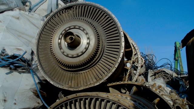 Broken Turbine Among Scrap Metal video