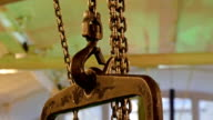 A bronze colored chain carrying heavy metal video