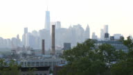 Brooklyn, New York City rooftop at sunset/night establishing shot video
