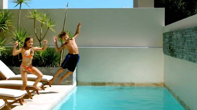 Brother and sister diving into the swimming pool video
