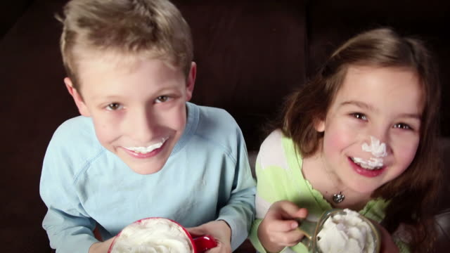 Brother and sister drink hot chocolate video