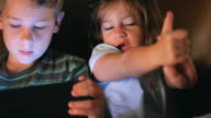 Brother and Sister Playing Handheld Video Game Player video