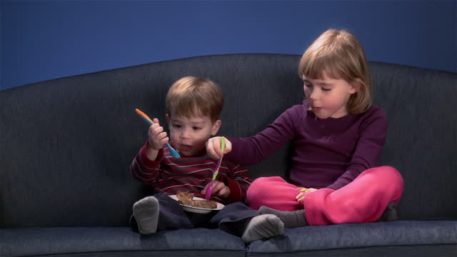 brother and sister sharing cake video
