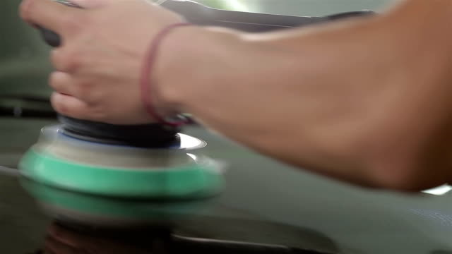 Brown car is polishing. Close up video