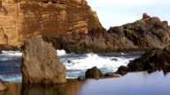 Brown cliffs and calm lagoon video