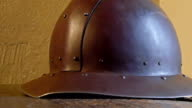 A brown metal hat used by ancient warriors during war video