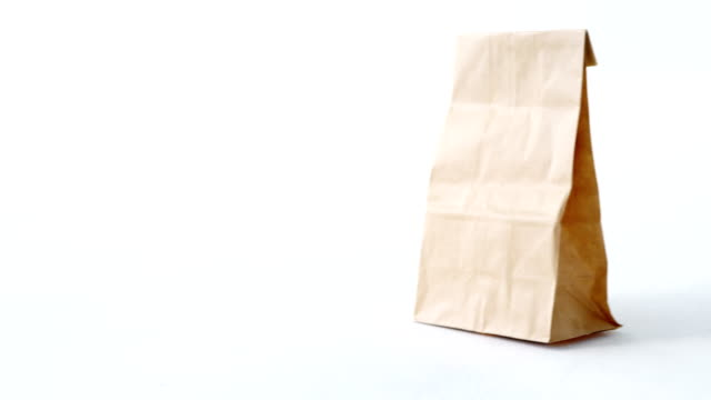 Brown shopping bag on white background video