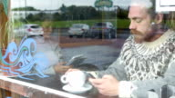 Browsing Smartphone in Cafe video
