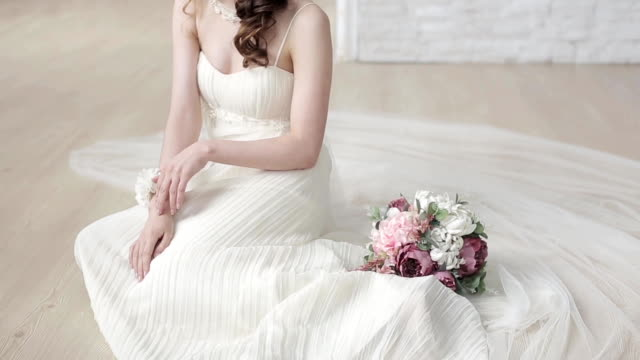 Brunette bride in fashion white wedding dress with makeup video