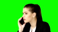 Brunette businesswoman hanging the phone angry. Green screen video