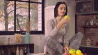 Brunette dieting eats fruits at home video