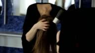 Brunette dries her long hair tilting head forward video