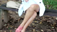 Brunette girl in the forest with colorful umbrella video