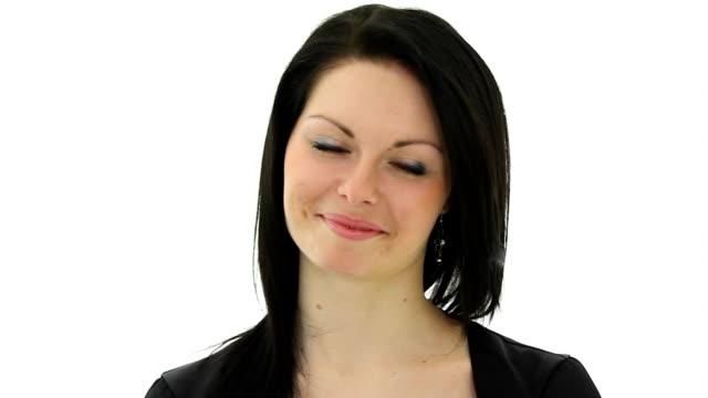 Brunette girl smiling and suddenly gets slap face dry fish. video