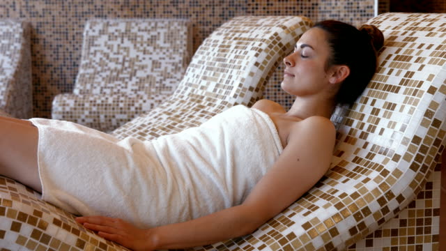 Brunette relaxing in thermal suite video