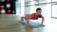 Brunette woman at gym push up push-up workout exercise video