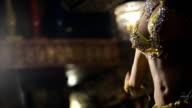 brunette woman dances belly dance in restaurant in light of soffits video