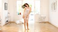 Brunette woman dancing video