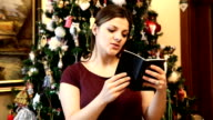 Brunette woman is reading at loud a Holy Bible.HD video