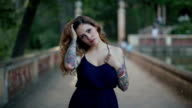 Brunette woman with tattoos video portrait video