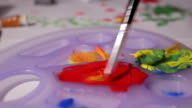 brush mixing colors close up video