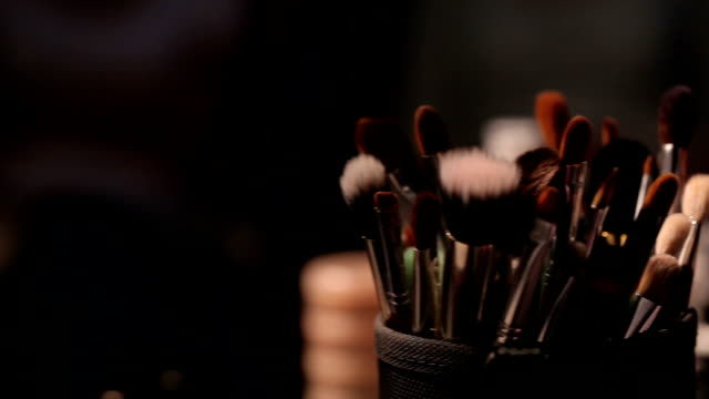 Brush set for make-up on table (dolly shot) video