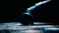 Brush vacuum cleaner sucks up dust on a black background.  Slow mo, slo mo video