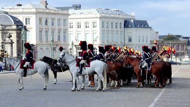Brussels guardians cavalry in traditional uniform, parade royal. Beautiful shot of Europe, culture and landscapes. Traveling sightseeing, tourist views landmarks of Belgium. World travel, west European trip cityscape, outdoor shot video