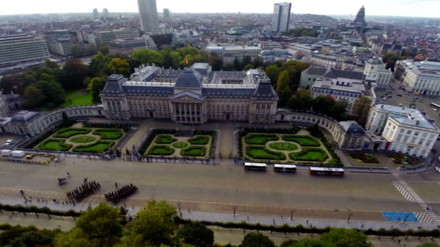 Brussels symbol Royal Palace marching cavalry city aerial view. Beautiful aerial shot above Europe, culture and landscapes, camera pan dolly in the air. Drone flying above European land. Traveling sightseeing, tourist views of Belgium. video