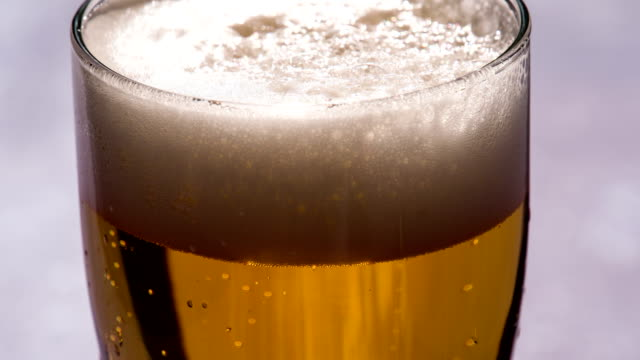 Bubbles and Foam in a Glass of Beer video