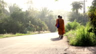 buddhist monks walking on country road video