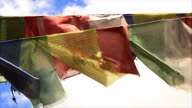 Buddhist prayer flags wave in the wind. video
